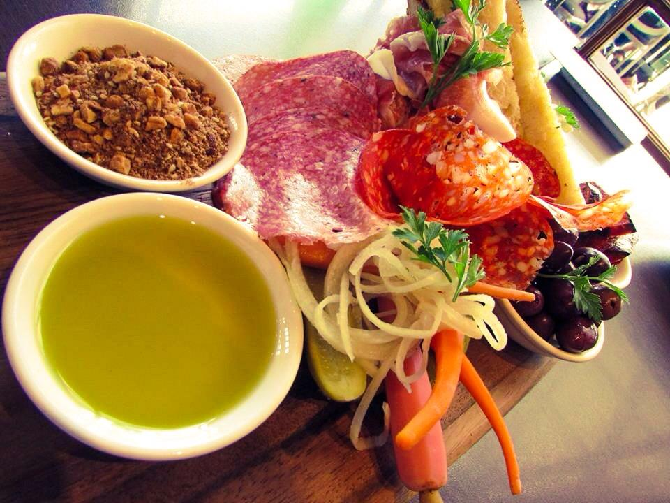 Our antipasto platter w chargrilled chorizo, local olives, sliced meats, feta, pickled baby vegetables, dukkah & Andy Clappis casalinga bread, can also be enjoyed outside in our beer garden.