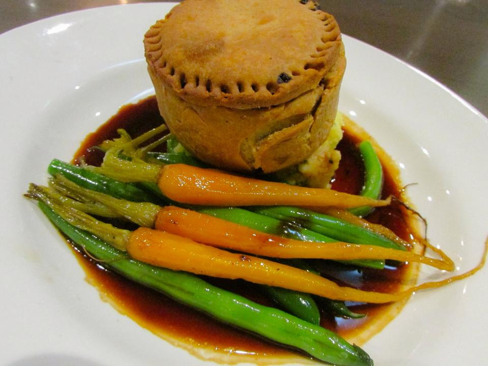 Coorong Angus beef, Coopers Stout & swiss brown mushroom Pie w spring onion mash, roasted baby carrots, green beans & jus.