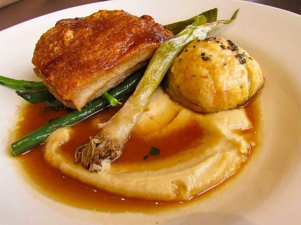 Roasted pork belly w cauliflower purée, baby leeks, local apple tarte tatin & jus.
