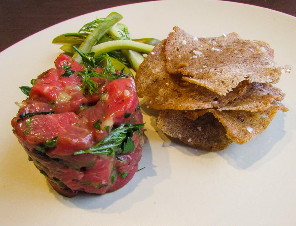 Our take on the Classic French beef tartare w pickled dill cucumbers & rye sourdough crisps.
